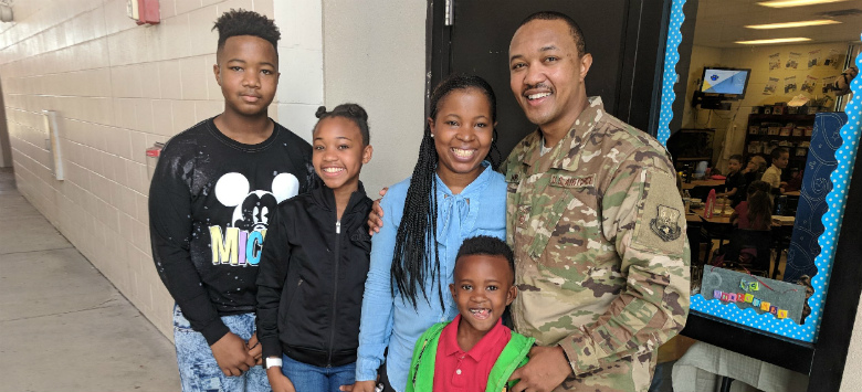 Image for Surprise! Military family reunites with stops at Orange Grove Middle, Robinson High and Tinker K-8