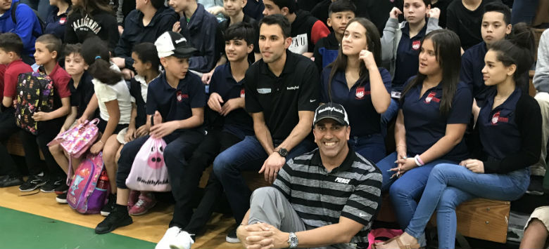 Image for Before Daytona 500, NASCAR driver Aric Almirola makes pit stop at Pierce Middle School